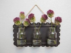 Metal tray holding vases
