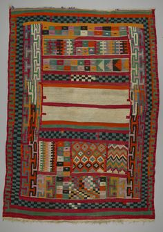 Gafsa blankets, or houlis, are characterized by their opposing panels of brightly coloured geometric patterns (triangles, squares, crosses and diamonds) separated by a central open area of off-white wool with single red stripes and crenellated borders. Used not as floor covering, but as rather as blankets, they were typically purchased at the time of a marriage.
