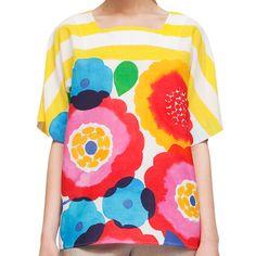 Marimekko Miniä shirt has been designed for Summer 2012 Collection by Tuula Pöyhönen, decorated by Kesäjuhla print by Aino-Maija Metsola, a pattern that combines stripes with aquarelle-like flowers.
