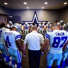 Dallas Cowboys praying before a game.