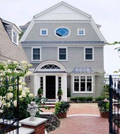 We love the gorgeous front entry to this nautical home. More entryway makeovers: http://www.bhg.com/home-improvement/exteriors/curb-appeal/entryway-designs/?socsrc=bhgpin071113brickwalkway=14