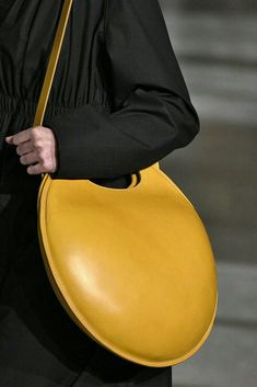 yellow leather bag. round bag