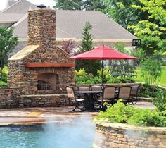 Backyard with a Giant Pool, Hidden Cave, Firepits, Slide, Pool House & More