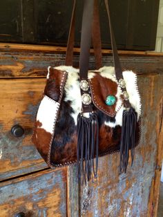 The Bonnie Bag, with side pockets, hand cut fringe and a turquoise stone. gowestdesigns.us