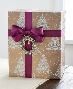 Metallic gold. Prismatic. And totally gorgeous. This wrap, ribbon and tie-on combination will make your gifts shine. Christmas Gift Wrapping, Diy Christmas Gifts, Holiday Gifts, Christmas Holidays, Christmas Decor, Creative Gift Wrapping, Creative Gifts, Wrapping Ideas, Gift Wraping
