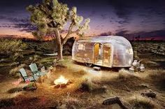 Airstream outdoor life with campfire.