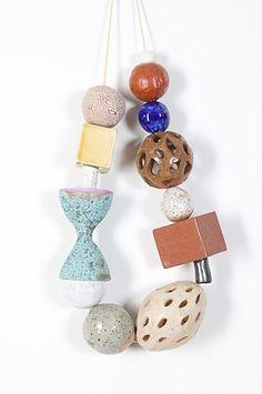 Katy Krantz. Gift 3 2011 ceramic and waxed string 24 x 11 x 3