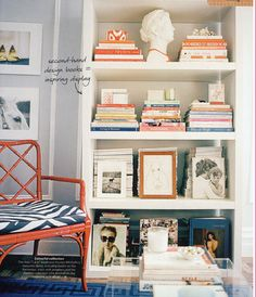 I can't handle how amazing this small space is - chair, cushion, rug, shelf with books and ikat bowl - omg!