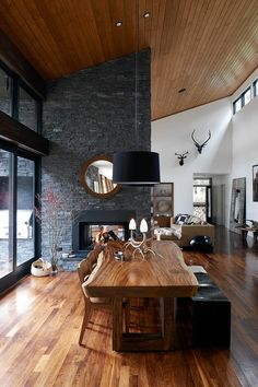 James Houston's Timber Lake House in Sullivan, N.Y. features bespoke wooden furniture in the dining room.