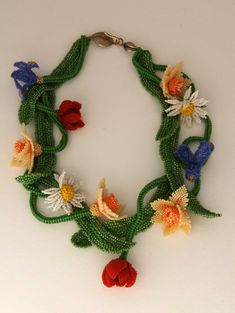 Spring Fling made by Huib Petersen is a great example of his command of making beaded flowers. So beautiful !