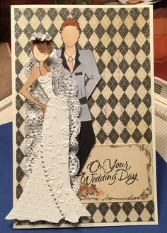 Wedding Card: 5 1/2 x 8 1/2 Stamps: Julie Nutting Prima Dolls Tasha & Adam, On Your Wedding Day by Great Impressions. Paper SU white & vanilla, DCWV the Primrose. Black and Grey Copic Markers. MS pansy punch for flowers, lace from Hobby Lobby, Silver Liquid Pearl. Embossing folders: Cuttlebug Swiss Dot and Sizzix English Rose.