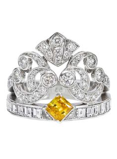 This Ballet Precieux Van Cleef & Arpels diamond and yellow diamond ring is just as pretty as a princess. (Via 1stdibs.)