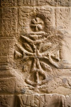 Christian cross carved over Egyptian hieroglyphics at Temple of Isis at Philae
