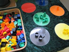 "Easy to cut circles out of scrapbook/construction paper, laminate or use contact paper, find lots of ""junk"" around the house! ;)"