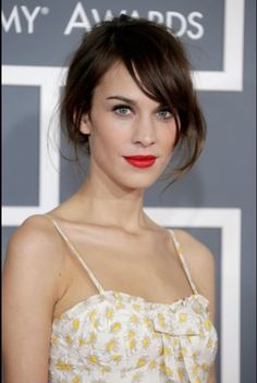 """Get Alexa's look:    Indie darling Alexa Chung looked simply sweet in a custom-blended bright red lip by makeup artist Tamah K. """"I actually mixed the color Alexa wore to the Grammys myself. It was a combo of many pigments,"""" she explained. To re-create the hue yourself, Tamah recommends using CoverGirl's LipPerfection Lipcolor in Hot, a true red, topped off with Nars Semi Matte Lipstick in Heat Wave. """"Heat Wave is vibrant orange, which will give the red a little more intensity."""""""