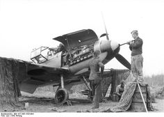 German crew cleaning the 20mm cannon of a Bf 109 fighter, Russia, early 1942