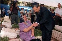 Former Israeli Prime Minister Ehud Barak comforts a bereaved mother at a memorial service for soldiers who died in the Yom Kippur War, when Israel's Arab neighbors invaded Israel on the holiest day of the Jewish calendar, inmore...