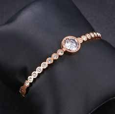 Elegant, refined and incredibly easy to wear, this rose gold-plated cubic zirconia cuff is a piece you can count on to lift any outfit, no matter what the occasion. The design elegantly combines a stunning round centerpiece with clear crystal pavé. A perfect gift for anyone who appreciates classic elegance with a twist. Anastasia Necklace, Branded Gifts, Sell Gold, Classic Elegance, Watches Online, Rose Gold Plates, Clear Crystal, Centerpiece, Swarovski Crystals