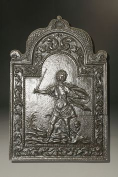 17th century French fireback with mythical warrior and serpent. #antique #fireback