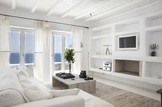 Greece Villa Living Room Design in Mykonos Beach Living Room, Coastal Living Rooms, Living Room Decor, Living Area, Style At Home, Beautiful Villas, White Furniture, Beach Furniture, House Furniture