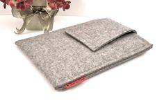 Beautiful felt e-reader, iPad cases on Etsy. Look at the whole line from this seller.
