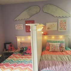 Shared little girls bedroom. Love it because each of them has their own space. #Sharedkidsrooms