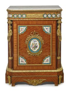 A Napoléon III gilt bronze mounted Sèvres style porcelain inset kingwood and tulipwood basket-weave parquetry side cabinet Paris, circa 1870 the carrara marble top over spring-loaded frieze drawer, the cupboard door opening to a single shelf.