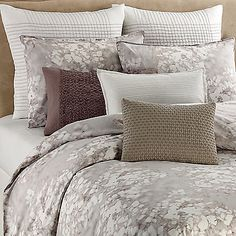 The Water Flower Duvet Cover from Vera Wang combines cool silver and lilac tones with luxurious textures to create a sophisticated look for your bedroom.