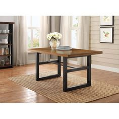 <p>Add an elegant lift to your space with the Better Homes and Gardens Mercer Dining Table. Featuring a sturdy metal frame and a multi-step finish wood seat, it accommodates up to six guests. This dining table goes well with other pieces from the Mercer Collection. Chairs and benches are sold separately.</p>