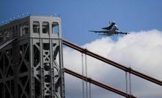 FORT LEE, NJ - APRIL 27:  Space shuttle Enterprise, mounted atop a 747 shuttle carrier aircraft, flies over the George Washington Bridge pri...