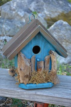 Rustic Birdhouse Blue Country Style  by BirdhousesByMichele, $60.00  This birdhouse hangs from recycled pipe fastener. Accents anyone's porch for birds to occupy during for nesting purposes. Great decorating idea!
