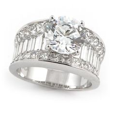 Image from http://www.wixonjewelers.com/wp-content/uploads/2013/12/wide-band-diamond-ring_365409_3.jpg.