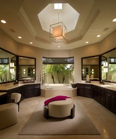 Luxury-master-bathroom-ideas-bay-window-beige-area-rug-beige-chair-modern-chandelier