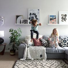 Family Living room featuring our monochrome abstract prints available in A4, A3 and 50 x 70cm poster.  Poster art gallery, picture rail, ikea picture shelf, scandinavian home interior, pattern love.