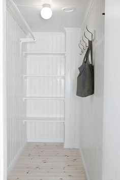 I like this closet with dowel rod better than new wire/shelved closets