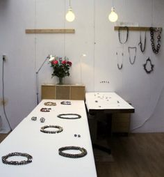 Exhibition/booth space. I love the spare surface. Really let's the jewelry take the spotlight.