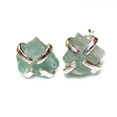 These organic free form ice blue aquamarine stud earrings are rustic and beautiful! They feature raw hammer cut pale blue aquamarine nuggets on a prong