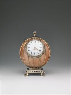 Spherical clock by Fabergé, workmaster Mikhail Evlampievich Perkhin, before 1899, in rose jasper, silver, silver gilt, gold, enamel, glass