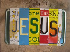 JESUS upcycled recycled license plate art on barn by tomboyART.