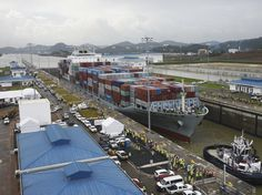 The cargo ship Cosco Houston crosses the new Cocoli Locks during a test at the Panama Canal on June 23, 2016. The canal's expansion project will be officially inaugurated on Sunday.