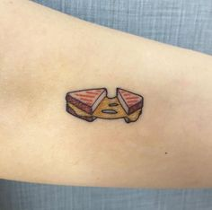 Tiny grilled cheese sandwich tattoo by Victoria Woon
