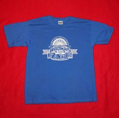 This is a Blue T-Shirt with the original International Circus Hall of Fame logo on it.