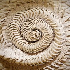 sculptural spiral made from canvas shoes!