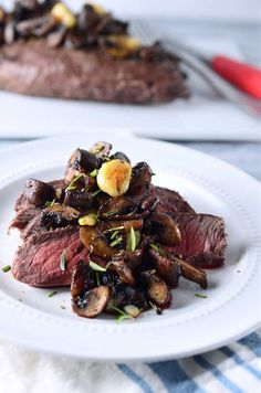 Perfectly tender flat iron steak topped with savory herb roasted mushrooms.