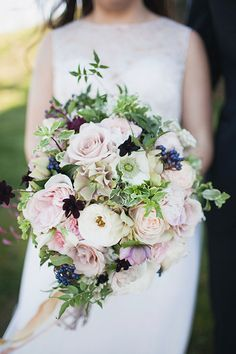 Loose, Organic Bouquet with Ranunculus, Roses, and Berries | Brides.com