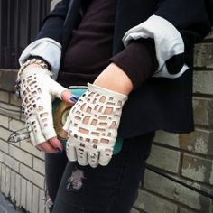 A fantastic tutorial to up-cycle simple leather gloves into fabulous ones.(via SEMI)