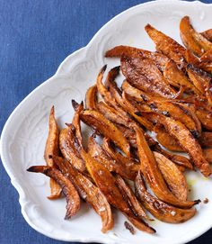 Sweet and Spicy Roasted Sweet Potatoes - womansday Vegetable Recipes, Vegetarian Recipes, Snack Recipes, Cooking Recipes, Side Recipes, Great Recipes, Favorite Recipes, Yummy Recipes, Baked Potato Oven