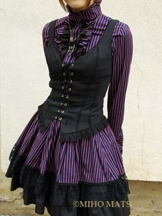 Love the corset - I think this would look awesome with some tight black pants, rather than the skirt.