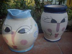 vasi lavorati al tornio decorati con colori da secondo fuoco.