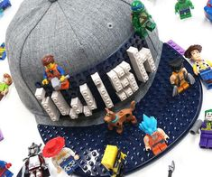 Accent your outfit with elaborate works of art by building them on this LEGO brick customizable hat. This trendy cap comes fitted with two LEGO mats over the front that can be used to construct anything your mind can imagine. Crazy Hair Day Boy, Crazy Hat Day, Crazy Hats, Crazy Socks, Legos, Lego Hat, Hobby Bird, Silly Hats, Lego Birthday Party